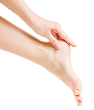 Foot Heel Skin Care, Woman Touch Healthy Feet Body by Hand, Leg Isolated over White Background