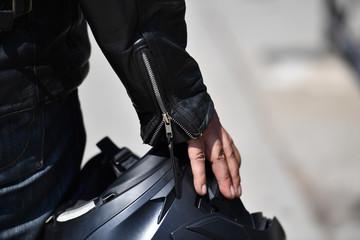 A man is wearing his motorcycle helmet