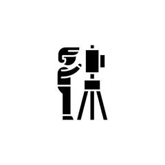 Professional photographer black icon concept. Professional photographer flat  vector symbol, sign, illustration.