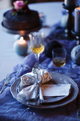 Table served for luxurious Wedding dinner in a dark room.