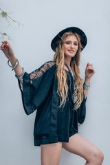 Portrait of beautiful young woman with makeup in black hat