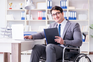 Disabled businessman working in the office