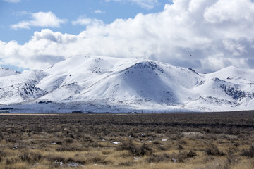 Beautiful mountainous country with snow on the hills in the desert