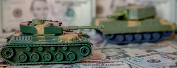 tank against the background of dollars. Concept of war