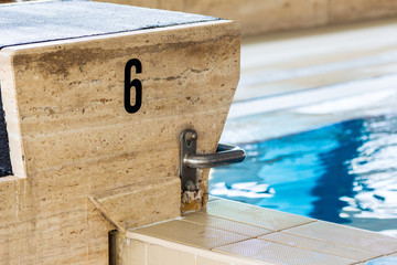 A starting block of a pool
