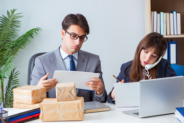 Business people receiving new mail and parcels