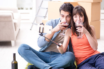 Couple taking selfie and drinking wine