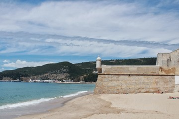 Views of the Sesimbra Beach and fortress in spring in Portugal