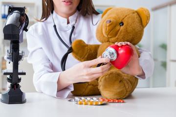 Child checking soft toy health