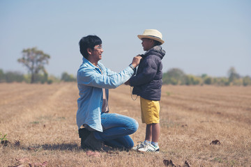 Small boyand father in the field,Summer and holiday concept
