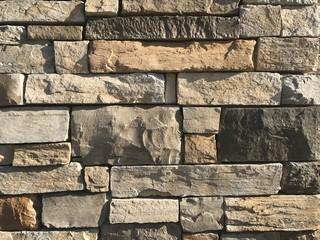 Stacked stone wall background. Photo image