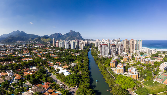 Aerial panorama of Barra da Tijuca near Lucio Costa Bridge on a sunny summer day. Rio de Janeiro.