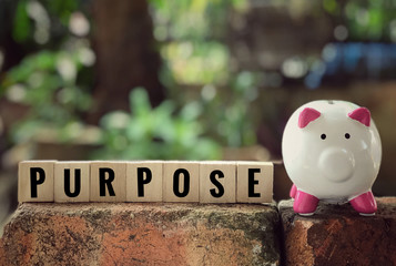 Conceptual - 'Purpose'written on a wooden blocks. With vintage styled background.