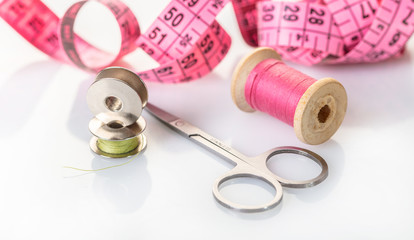 spool of pink thread and meter