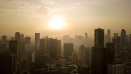 Downtown Jakarta under warm a sunset