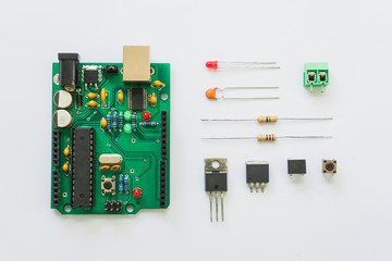 Top view of electronics component such as PCB board, resistor, ICs, capacitor, switch, and connector. Wall mural