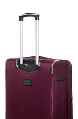 Travel suitcase with pull-out handle on a white background, side view