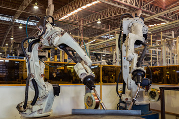 Robots welding team in the automotive parts industry are in teaching mode