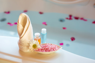 Soft and select focus Spa massage compress balls, herbal ball and treatments spa decoration, natural organic products on a bathtube.; Spa Thailand.
