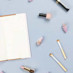 Note book, woman beauty accessories flat lay on pastel background. Fashion or beauty blogger concept.