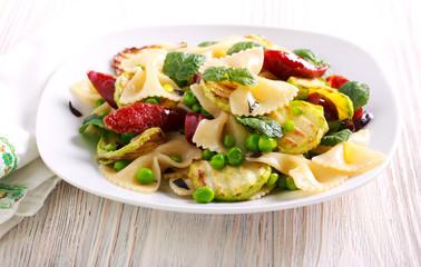 Farfalle, pea, zucchini and sausage salad
