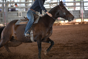 Horse And Rider Barrel Racing At A Rodeo