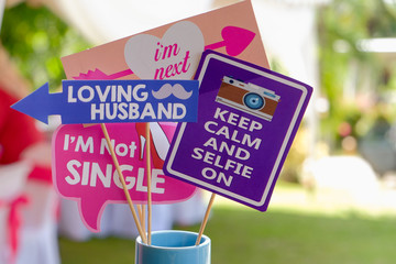 Photo booth props colors text design, Props for photos on weddings featuring cute and funny phrases.