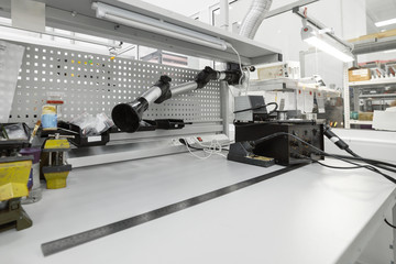 Workplace for the assembly of industrial electronic modules.