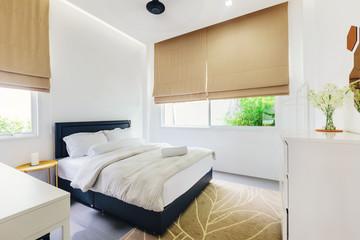 Modern bed room interior in Luxury villa. Big windows, white colours