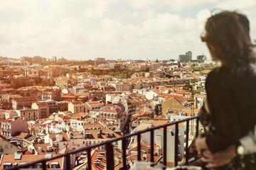 Traveling couple watching Lisbon city landscape