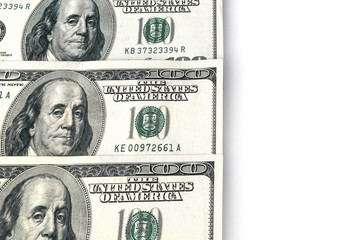 A background of hundred dollar bills lying on the left side and a white part on the right.