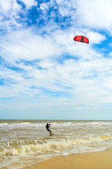 Kiteboarding. A kite surfer rides the waves. Holidays on nature. Artistic picture. Beauty world.