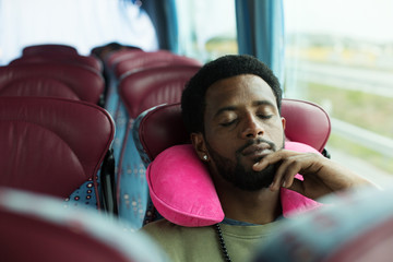 Portrait of man sleeping in touristic bus