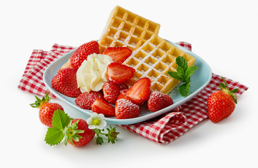Fresh ripe strawberries with waffles and cream