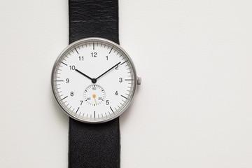 Minimalist wristwatch white dial on white background Fototapete
