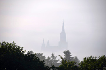 cathedral of ulm shrouded in the deep fog
