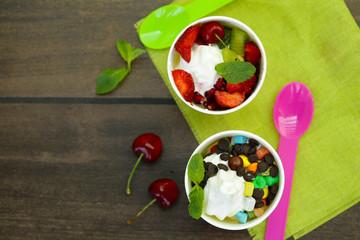 frozen yogurt with berries and sweets - summer dessert