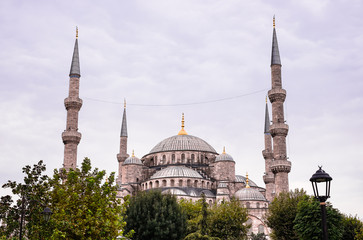 The Sultan Ahmed Mosque also known as The Blue Mosque, a historic mosque located in Istanbul, Turkey. It sits next to the Hagia Sophia, another popular tourist site. Image with copy space.