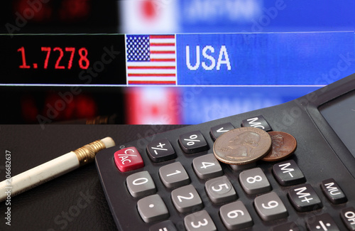 Coin Of United Stage America On Calculator And Pencil Black Floor With Digital Board
