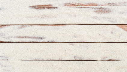 Sand on the wooden planks. Abstract background.