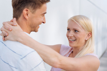 Laughing loving young blond wife