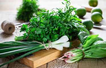 Bunch of fresh homegrown organic parsley, spinach, arugula and spring onion