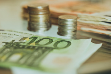 Cash, pyramids of coins, paper money, metal money.