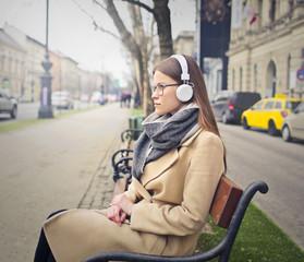 Classy woman wearing white headphones