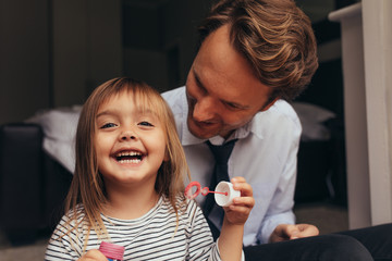Father and daughter playing at home