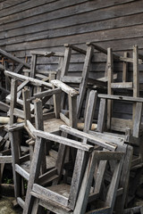 Broken vintage wooden chairs in old school