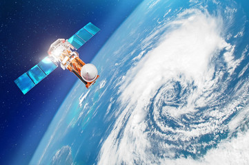 Satellite above the Earth makes measurements of the weather parameters. Research, probing, monitoring of tracking in a tropical storm zone, a hurricane. Elements of this image furnished by NASA.