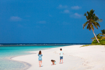 Wall Mural - Mother and kids at tropical beach
