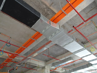 Electrical conduit, cable tray and aircond pipes as part of services above ceiling installed at the construction.