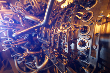Gas turbine engine of feed gas compressor located inside pressurized enclosure, The gas turbine engine used in offshore oil and gas central processing platform.